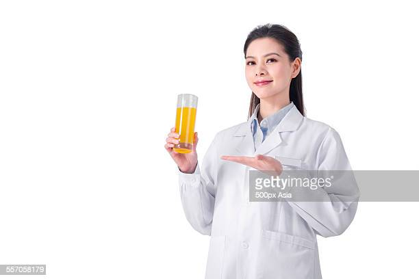 Young Nutritionist Holding a Glass of Juice