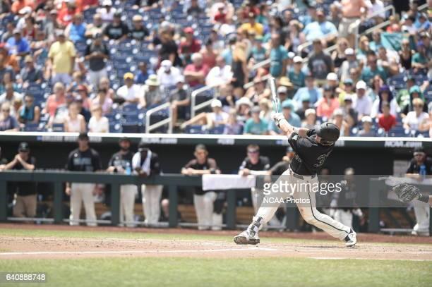 K Young of Coastal Carolina University blasts a homerun against the University of Arizona during Game 3 of the Division I Men's Baseball Championship...