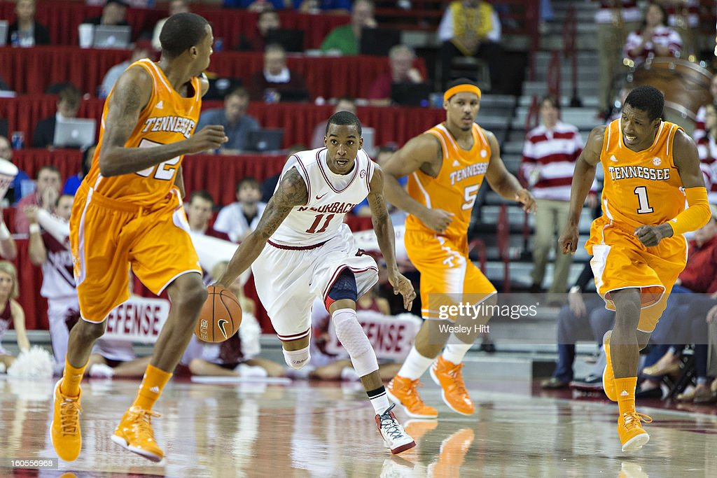 BJ Young #11 of the Arkansas Razorbacks dribbles the ball down the court against the Tennessee Volunteers at Bud Walton Arena on February 2, 2013 in Fayetteville, Arkansas. The Razorbacks defeated the Volunteers 73-60.