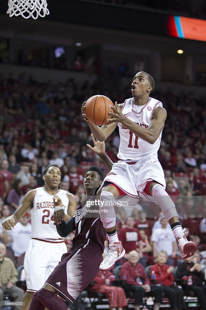 BJ Young #11 of the Arkansas Razorbacks drives the basket during a game against the Mississippi State Bulldogs at Bud Walton Arena on January 23, 2013 in Fayetteville, Arkansas. The Razorbacks defeated the Bulldogs 96-70.