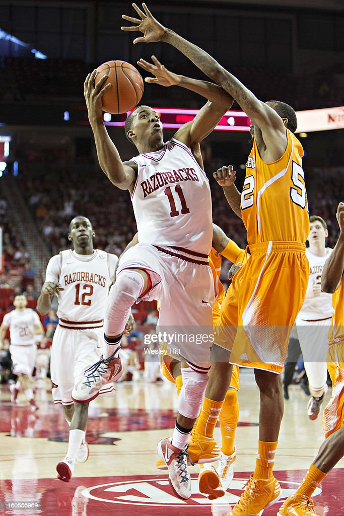 BJ Young #11 of the Arkansas Razorbacks goes up for a shot against Jordan McRae #52 of the Tennessee Volunteers at Bud Walton Arena on February 2, 2013 in Fayetteville, Arkansas. The Razorbacks defeated the Volunteers 73-60.
