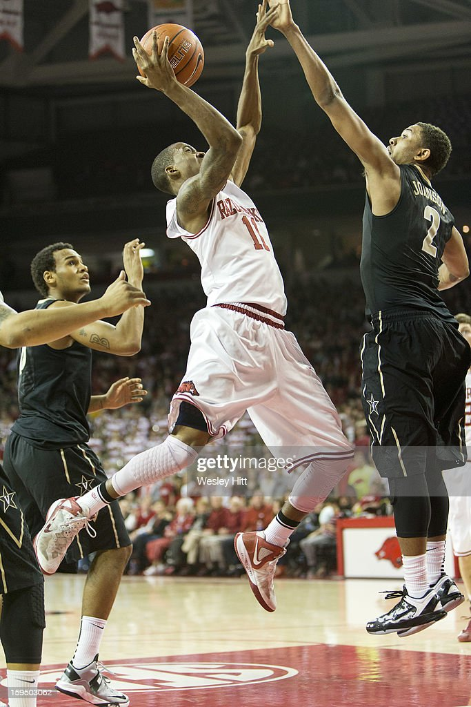 BJ Young #11 of the Arkansas Razorbacks goes up for a shot over Kedren Johnson #2 of the Vanderbilt Commodores at Bud Walton Arena on January12, 2013 in Fayetteville, Arkansas. The Razorbacks defeated the Commodores 56-33.