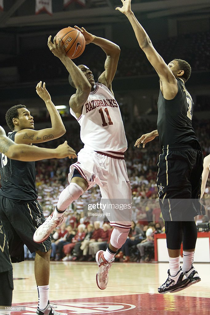 BJ Young #11 of the Arkansas Razorbacks takes a jump shot against the Vanderbilt Commodores at Bud Walton Arena on January12, 2013 in Fayetteville, Arkansas. The Razorbacks defeated the Commodores 56-33.