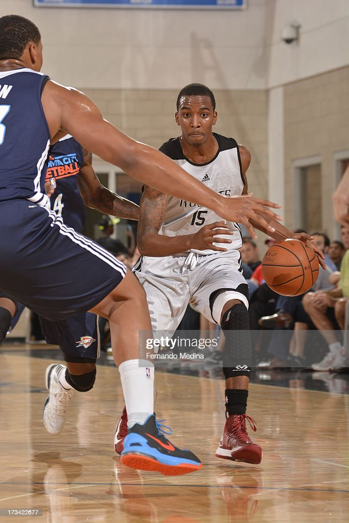 B.J. Young #15 of the Houston Rockets drives up court during the 2013 Southwest Airlines Orlando Pro Summer League game between the Oklahoma City Thunder and the Houston Rockets on July 12, 2013 at Amway Center in Orlando, Florida.