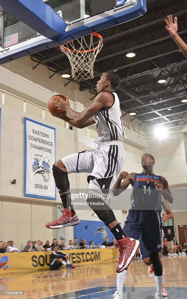 B.J. Young #15 of the Houston Rockets goes to the basket during the 2013 Southwest Airlines Orlando Pro Summer League game between the Oklahoma City Thunder and the Houston Rockets on July 12, 2013 at Amway Center in Orlando, Florida.