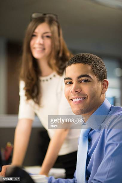 young office workers happy at their desk