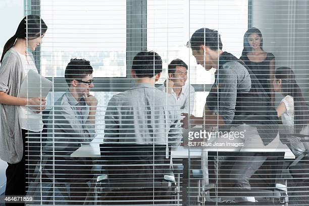Young office workers holding a meeting