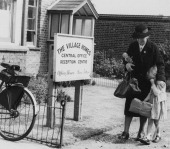 A young orphan named Jane arrives with a travelling matron at her new home Barkingside Village Home run by the Barnardo's charity near Ilford Essex...