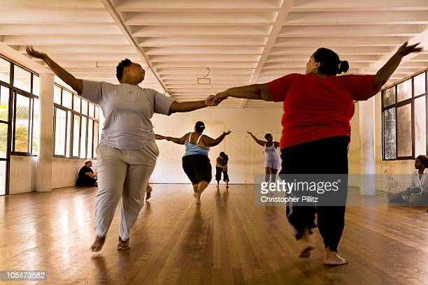 Young overweight women rehears new choreography