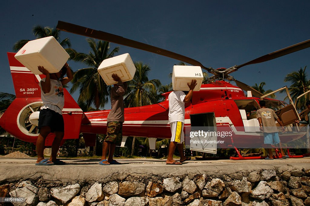 Young oysters being transported by helicopter to one of the other farms to continue their growth. Jacques Branellec has arrived to inspect the farm, having piloted a helicopter to Palawan, 500km from Manila, where he lives. Jacques Branellec is a director and co-founder of pearl production company Jewelmer International, set up in 1979, which has six pearl oyster farms in the Philippines. They specialize in production of golden pearls, and are the only company in the world able to produce them. Each pearl takes 5 years to grow, under very carefully controlled conditions, and can fetch huge sums of money when developed to perfection.