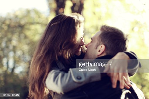 Young pair hugging each other in park : Stock Photo