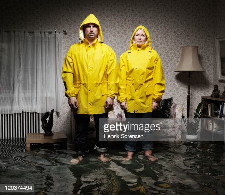 young pair in flooded room