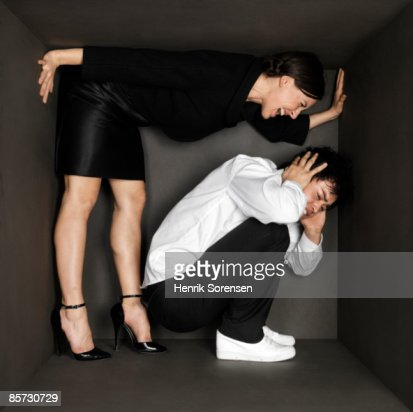 Young pair inside a small black room
