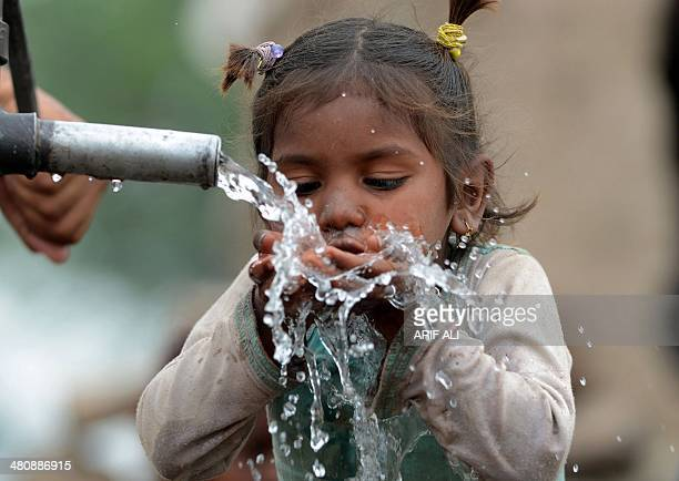 A young Pakistani girl drinks from a hand pump in Lahore on March 27 2014 More than 25 billion people are in need of decent sanitation and nearly one...