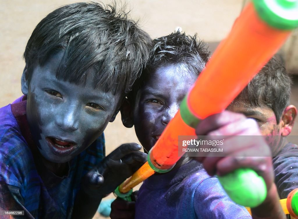 Young Pakistani Hindus pose with water guns during Holi celebrations in Karachi on March 26, 2013. Holi, or festival of colours, is a popular Hindu spring festival observed at the end of winter season on the last full moon day of the lunar month.