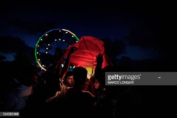 Young Palestinian attempt to light a hot air lantern September 11 2010 outside an amusement park on the outskirts of Gaza City on the second day of...