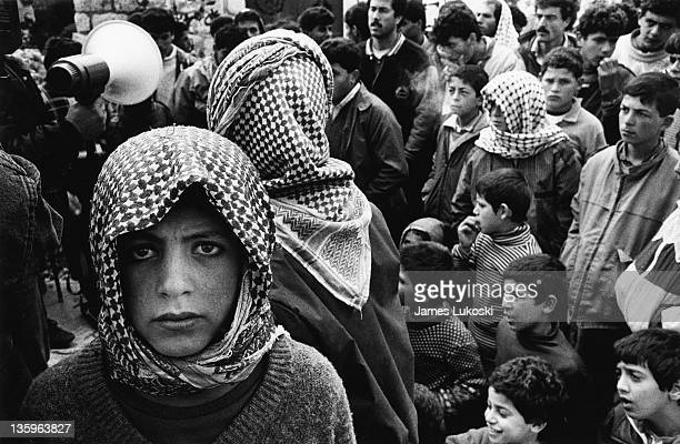 A young Palestinian attends a demonstration at Kufr Neimeh in the West Bank during the IsraeliPalestinian conflict circa 1990 They are commemorating...