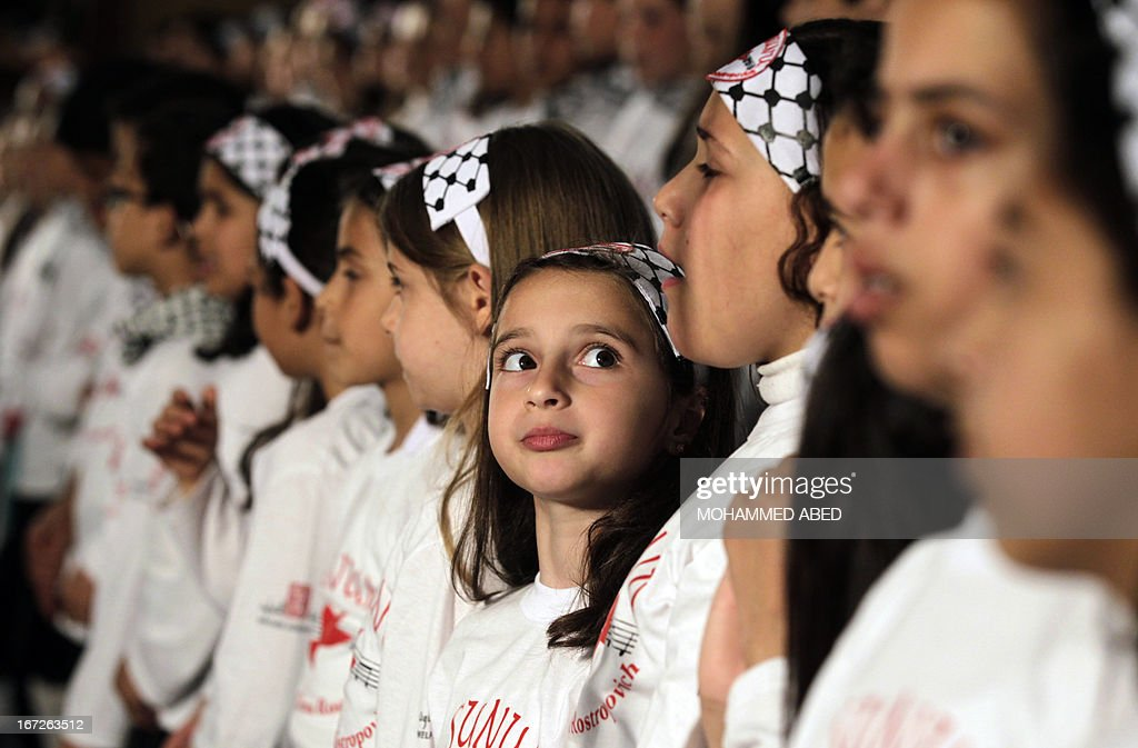 Young Palestinian choir members, who attend an UNRWA (United Nations Relief and Works Agency for Palestine Refugees in the Near East) funded school, sing during a performance of the 'al-Sununu' concert on April 23, 2013, in Gaza City. The Elena Rostropovich association, in cooperation with UNRWA are organizing the 'al-Sununu' (The Swallow) concert which will involving a total of 23 choirs from across the Levant, including the Palestinian West Bank and Gaza Strip, Jordan, Syria and Lebanon, and will be linked via satellite.