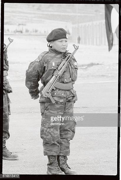 A young Palestinian guerilla with his AK47 slung on his chest stands at attention as Yasser Arafat addresses PLO guerillas at this training camp 700...