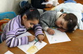 ZAANOUN Young Palestinian orphans draw as they sit in a classroom at the SOS Children's Village in Rafah in the southern Gaza Strip on April 15 2009...