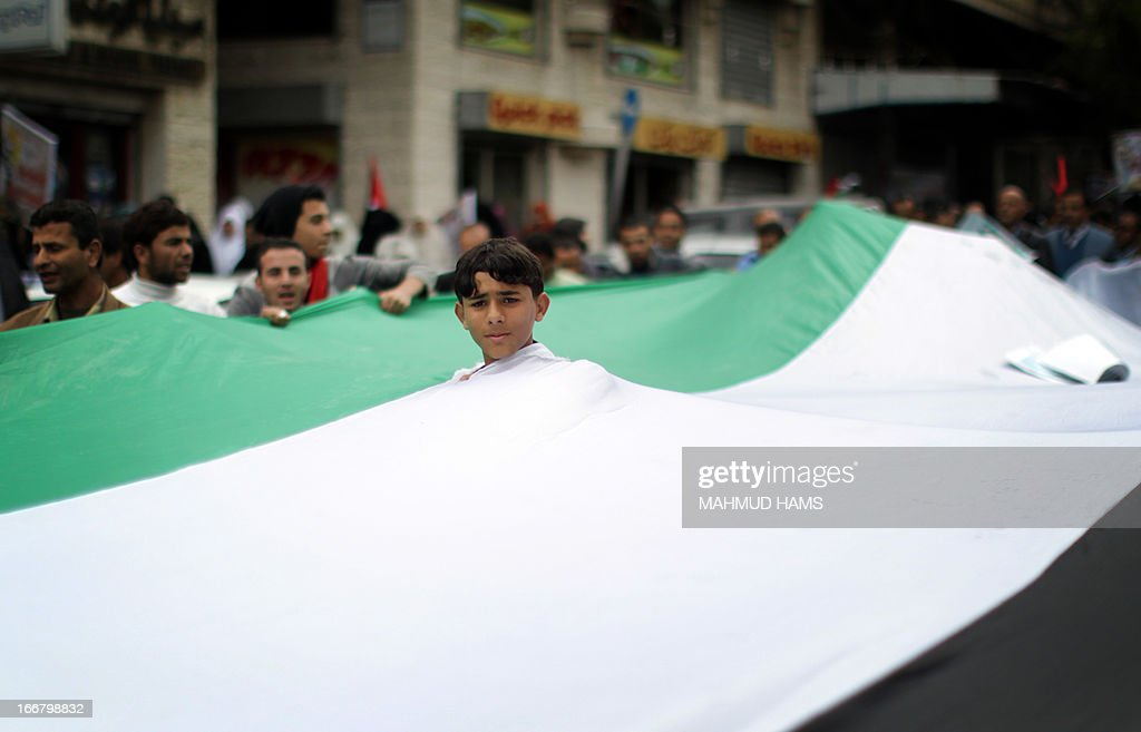 A young Palestinian protesters is seen during a rally to commemorate Prisoners' Day in Gaza city April 17, 2013. Palestinians across the territories are attending marches and rallies as a show of solidarity with prisoners from the West Bank, east Jerusalem and Gaza held in Israeli facilities, whose numbers according to Israeli rights group B'Tselem reach 4,713.