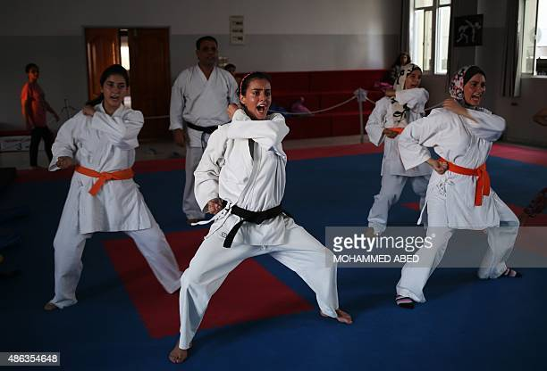 Young Palestinian women attend a Karate class at alMasthal club in Gaza City on September 3 2015 The eighteen students aged between fourteen and...