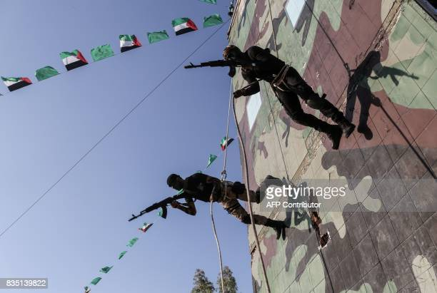 Young Palestinians abseil during a military graduation ceremony at a Hamas summer camp in Khan Yunis in the southern Gaza Strip on August 18 2017...