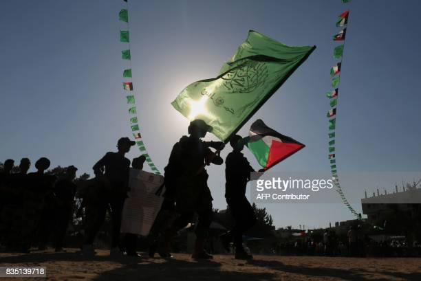 Young Palestinians march during in a military graduation ceremony at a Hamas summer camp in Khan Yunis in the southern Gaza Strip on August 18 2017...