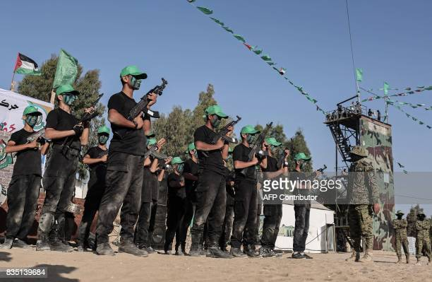 Young Palestinians take part in a military graduation ceremony at a Hamas summer camp in Khan Yunis in the southern Gaza Strip on August 18 2017...