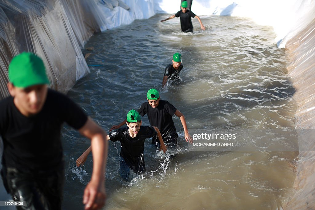 Young Palestinians take part in a military-style exercise during a summer physical training camp run by Hamas in Gaza City on June 17, 2013.