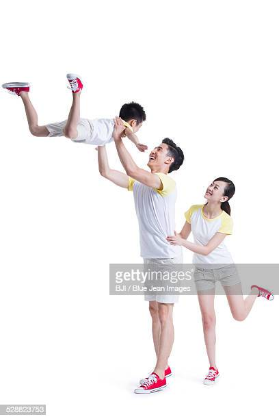 Young parents playing with son