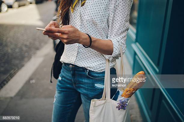 Young Parisian woman using the smartphone