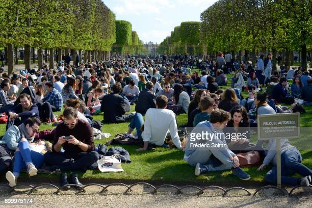 Young Parisiens enjoying the sun in Jardin du Luxembourg on May 10 2017 in Paris France