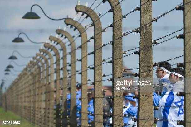 Young participants look through barbed wire fence during the annual March of the Living inside the former German Nazi Death Camp AuschwitzBirkenau...