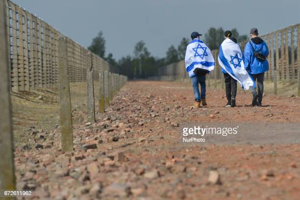 Young participants walk near barbed wire fence during the annual March of the Living inside the former German Nazi Death Camp AuschwitzBirkenau...