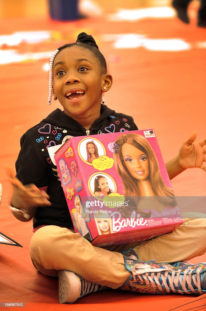 A young partygoer expresses her joy for the Barbie toy she received during the Chicago Bulls USO / Chicago Housing Authority Holiday Party on December 9, 2012 at the Sheri L. Berto Center in Deerfield, Illinois.