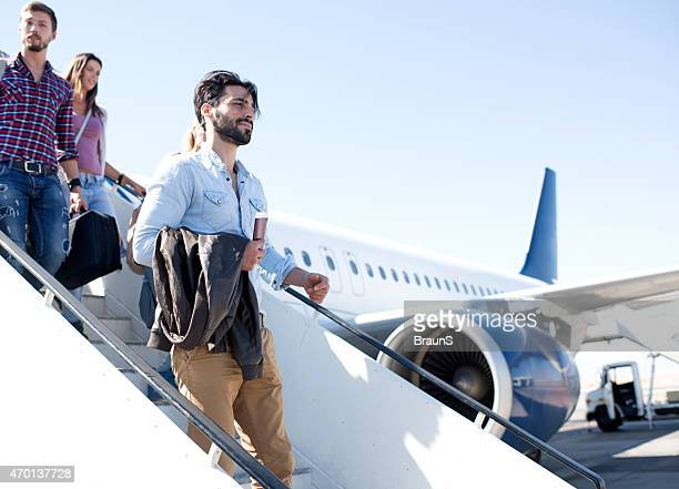 Young passengers getting out of the airplane.