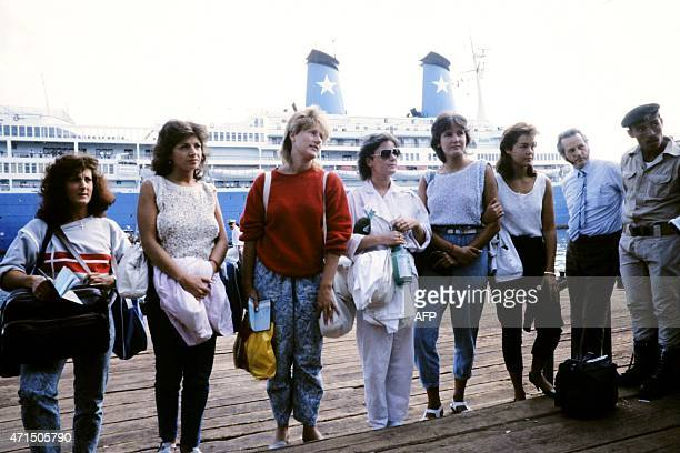 Young passengers pose on October 10 1985 at Egyptian port of Port Said after they have disembarked from Italian cruise liner Achille Lauro Achille...