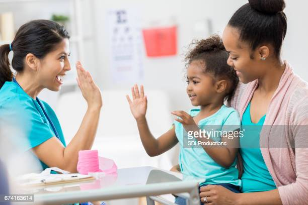 Young patient gives nurse high five