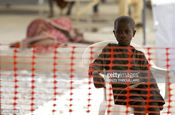 A young patient sits at the Ebola treatment centre run by French Red Cross Society in Macenta on November 21 2014 The World Health Organisation said...
