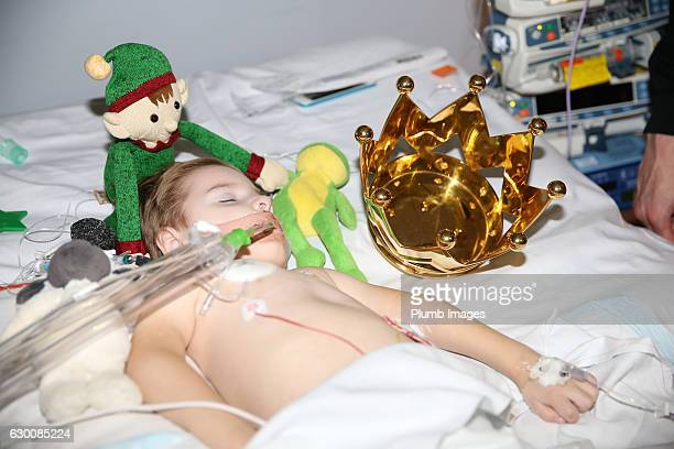 A young patient sleeps as the Leicester City players deliver Christmas presents to patients at Leicester Royal Infirmary on December 15 2016 in...