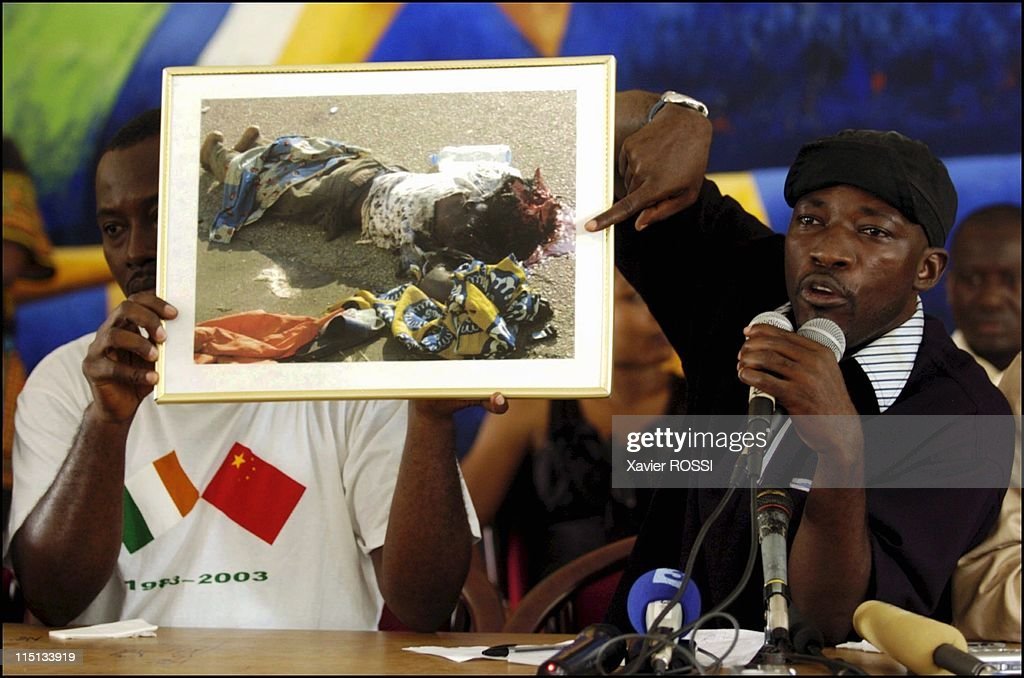 Young patriots meeting in the town hall of Cocody district in Abidjan, Cote D'Ivoire on November 16, 2004 - General Charles Ble Goude showing a picture of a woman from the Ivory Coast killed by french army during recent clashes.
