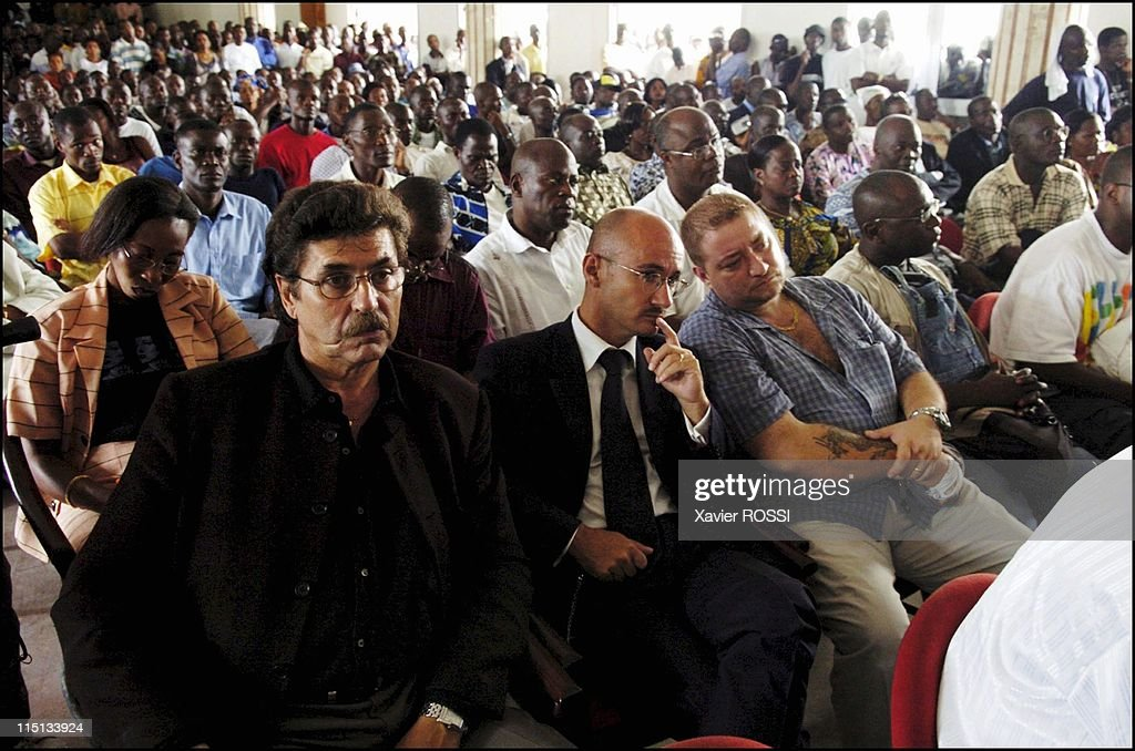 Young patriots meeting in the town hall of Cocody district in Abidjan, Cote D'Ivoire on November 16, 2004 - French man supporting the patriotic alliance mouvement of General charles Ble Goude. From the left to the right : Jean Claude Carre, Yann Voisin, Jean-Claude Vanier.