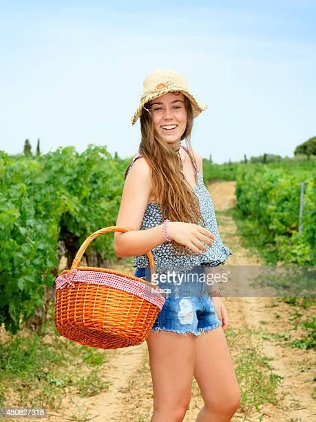 Young peasant girl at a vineyard