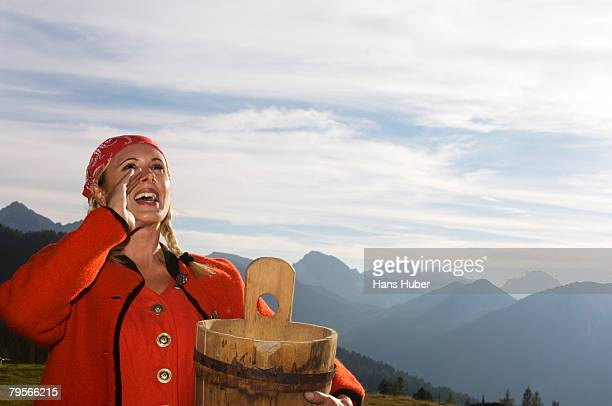 'Young peasant woman holding buttere tub, shouting'