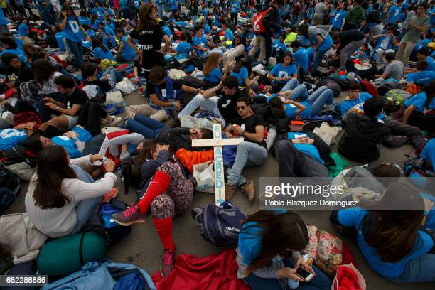 Young pelgrims takes some as they wait for the arrival of Pope Francis at the Sanctuary of Fatima on May 12 2017 in Fatima Portugal Pope Francis will...
