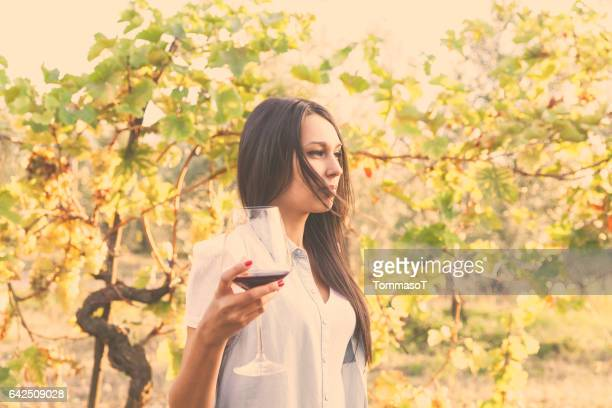 young pensive woman in a vineyard