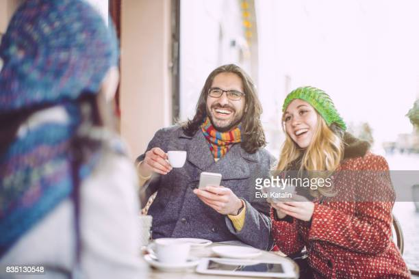 Young people are having fun in a coffee shop
