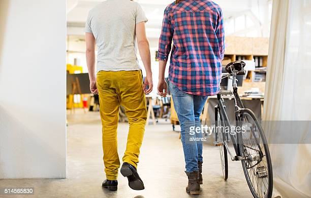 Young people arriving at work with a bicycle