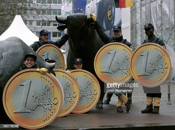 Young people as 'wandering 1 Euro coins' are distributing information to the EURO topic in Frankfurts centre Our picture shows a group at the...